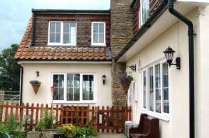 White upvc windows on a cream traditional house