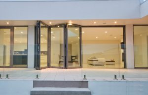 An open aluminium bifold door