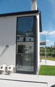 Tall black aluminium window