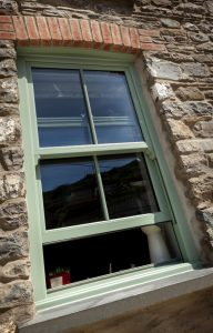 Chartwell green vertical sliding window