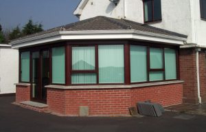 Rosewood uPVC sunroom with a tiled roof