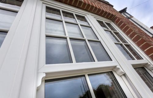 Close up of a white uPVC vertical sliding window