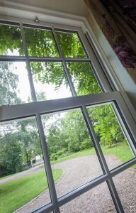 Vertical sliding window from inside with driveway