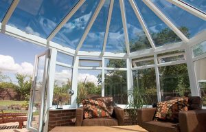 Victorian conservatory interior with brown furniture