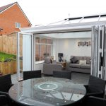 White Bifold Conservatory with doors open.