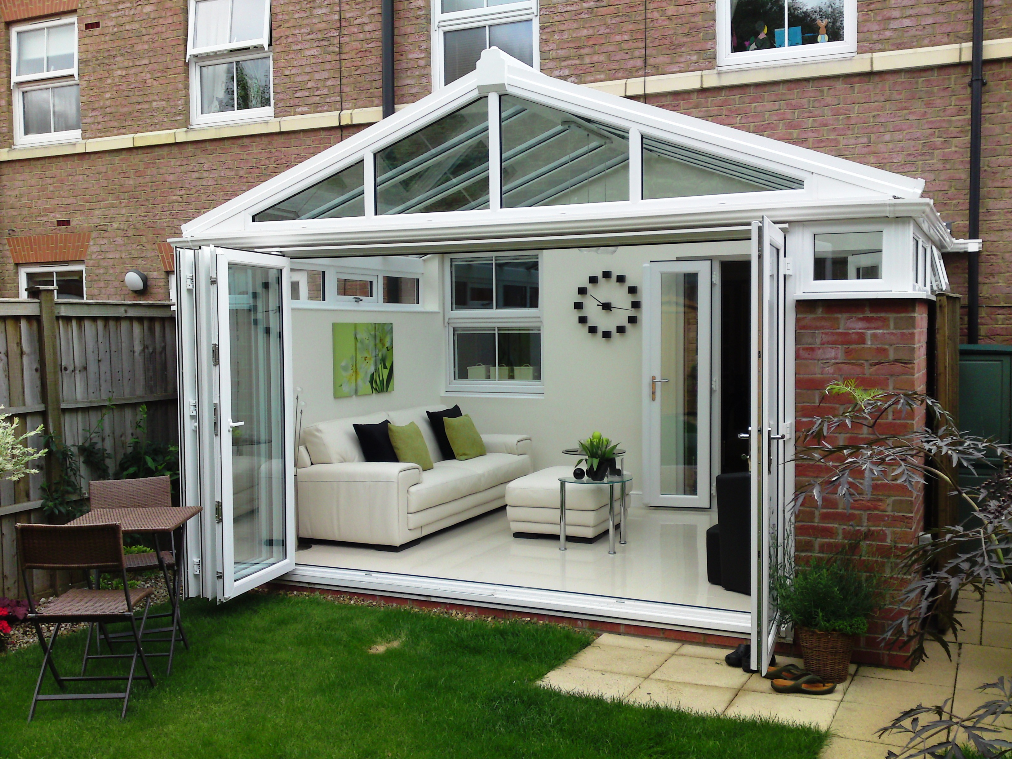 Ultraframe conservatory with open bifold doors.