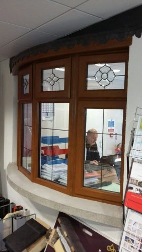 A brown bow window in our home improvement showroom.