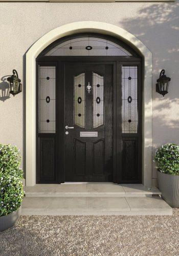 Ornate black front door.
