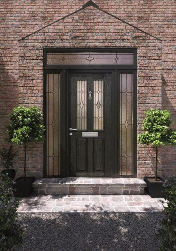 Black front door with surrounding window panels.
